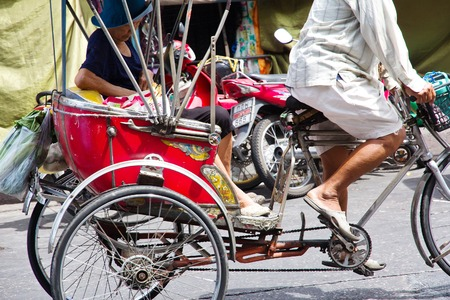 NONTHABURI PROVINCETHAILAND  JUNE 1 2015 : Rickshaw in Nonthaburi Province on June 1 2015. The Rickshaws are a popular way to tour the city. Rickshaw in Nonthaburi Traditional vehicle of Thailand