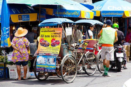 nonthaburi province: NONTHABURI PROVINCETHAILAND  JUNE 1 2015 : Rickshaw in Nonthaburi Province on June 1 2015. The Rickshaws are a popular way to tour the city. Rickshaw in Nonthaburi Traditional vehicle of Thailand