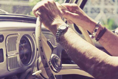driving car: Older man driving a car