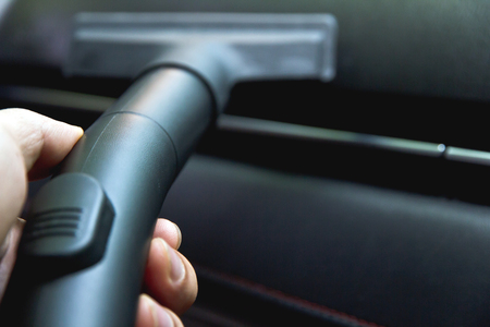 technology career: Vacuuming car interior Stock Photo