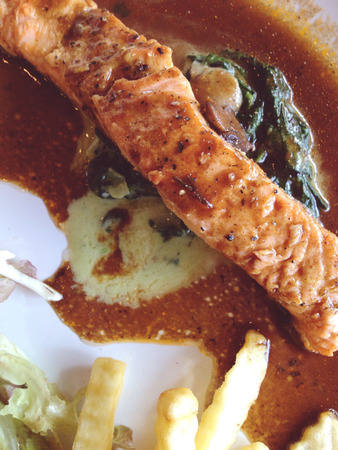 broiled: broiled salmon with french fries and salad Stock Photo