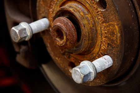 hubcap: rusty brake disk and detail of the wheel hub,auto repair concept
