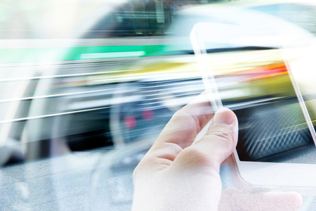 mobile phone: Using smart phone double exposure and blurred view of car on city street