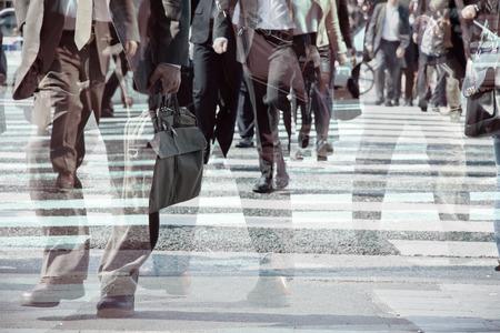 multiple exposure: Multiple exposure image of businessman walking Stock Photo