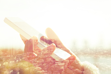 business equipment: Using smart phone double exposure and cityscape background. Business  technology concept.