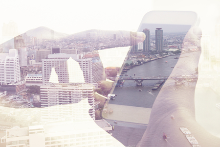 cityscapes: Double exposure image of people with smart phone and cityscape background,Business technology concept.