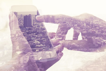 mobile phones: Double exposure image of people with smart phone and cityscape background,Business technology concept.