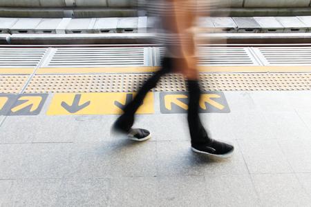 urbanism: urbanism,people and arrow sign on skytrain station floor