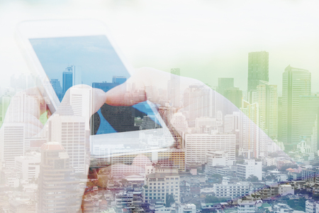 technology: Business  technology concept. Double exposure of smart phone and cityscape background.