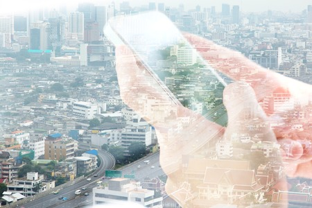 city people: Double exposure image of people with smart phone and cityscape background. communication technology concept.