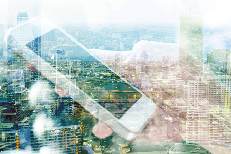 composite image: Double exposure image of people with smart phone and cityscape background. communication technology concept.