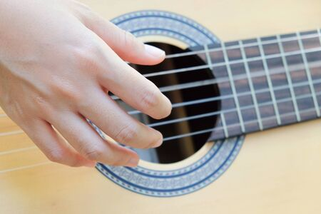 domestic life: Close up image of Man playing his guitar