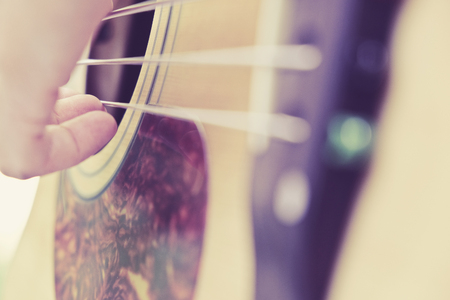 bass guitar: Guitar player background,close up of 5 string acoustic bass guitar. Stock Photo