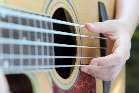 musical instrument parts: Guitar player background,close up of 5 string acoustic bass guitar. Stock Photo