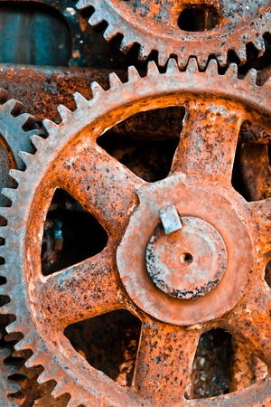 grooved: close up image of Rusty cogwheels background