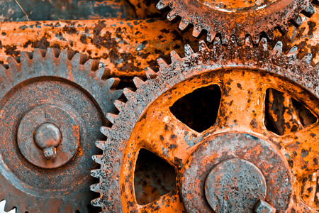 construction machinery: close up image of Rusty cogwheels background