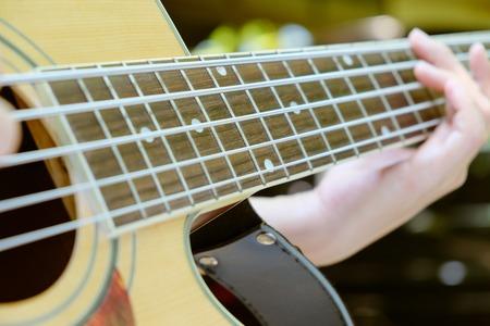 musical instrument parts: acoustic bass guitar.close up of 5 string acoustic bass guitar.