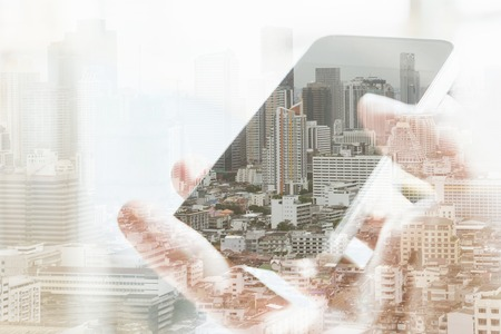 concept images: Double exposure image of people with smart phone and cityscape background,Business technology concept.