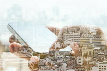 multiple ethnicity: Double exposure of cityscape and smart phone, business technology concept.