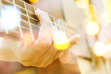 musical instrument parts: Multiple exposure of guitar player and Bokeh