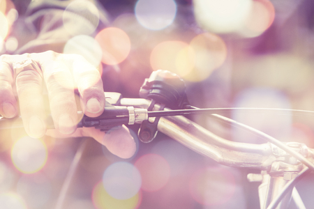 multiple exposure: Multiple exposure of man riding a bike and Bokeh Stock Photo