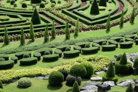 formal garden: Garden path with topiary landscape background