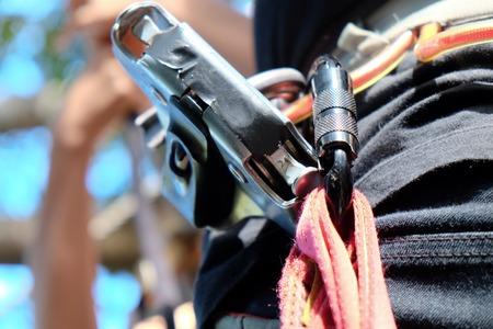 belaying: Climbing Gear,close up of Mountain climber wearing carabiners Stock Photo
