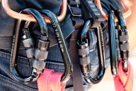 carabiner: rock climbing gear,close up of Mountain climber wearing carabiners Stock Photo
