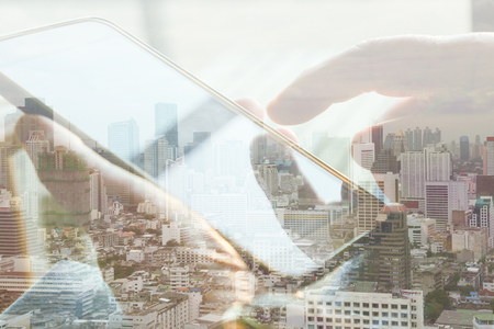 multiple ethnicity: Double exposure of cityscape and smart phone, communication technology concept.