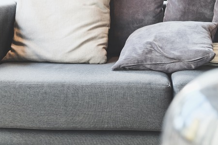 living room: cushion on sofa,detail image of cushion on sofa, modern living room Stock Photo