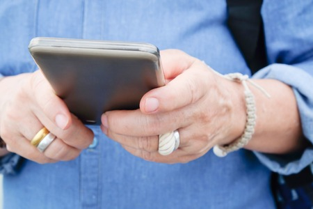 wireless telephone: image of older woman with smart phone Stock Photo