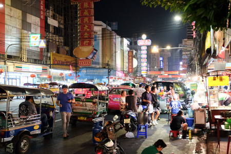 gold road: CHINATOWN, BANGKOK, THAILAND - 28 JANUARY, 2016: Yaowarat Road at night, street food, gold shop. Restaurant,etc., Famous and Popular destinations for tourists.