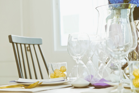 dining room interior: Close up of Place settings on elegant dining table