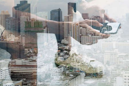 Double exposure image of people with smart phone and cityscape,communication technology concept