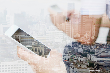 composite image: Double exposure image of people with smart phone and cityscape background,communication technology concept. Stock Photo