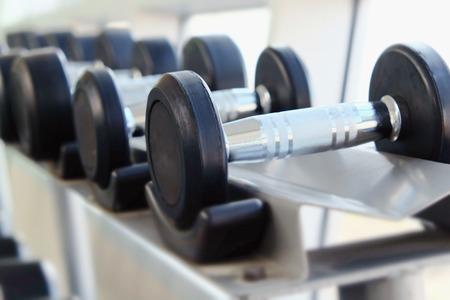 dumb bells: Dumb bells lined up in fitness room