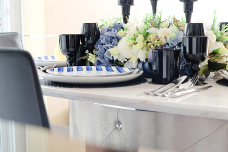 showcase interiors: Detail image of Place settings on elegant dining table Stock Photo