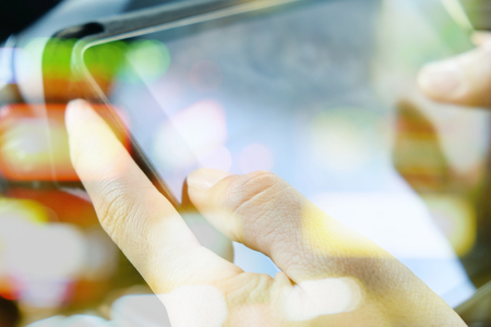 palmtop: digital tablet.close up image of business man Sitting in the Car and Using digital tablet.