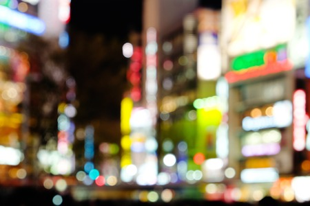city traffic: Out of focus lights in Shibuya Crossing at night Stock Photo