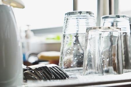 Washing dishes.