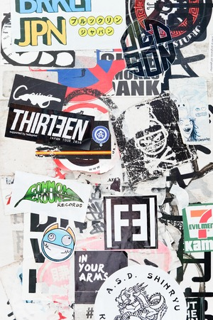 Harajuku: Tokyo, Japan - March 30, 2016 :Bumper stickers and graffiti on the street,Harajuku,Tokyo Japan.Harajuku is known as a center of Japanese youth culture and fashion.