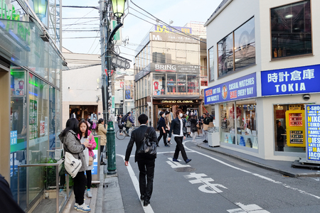 harajuku: TOKYO JAPAN - March 30, 2016: People in Ura-Harajuku street. The area is world-famouse as the centre of fashion and culture for Japanese youth.