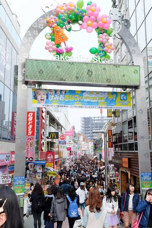 adulation: TOKYO, JAPAN - MARCH 30 2016: Takeshita Street(Takeshita Dori) in Harajuku. Takeshita Dori is considered a birthplace of Japans fashion trends.