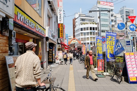 clothing stores: TOKYO - MARCH 31, 2016: lifestyle around Koenji Station on MARCH 31,2016 in Tokyo. Koenji is famous firstly as a center of alternative youth culture,in particular for its second-hand clothing stores