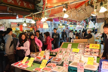 city fish market: TOKYO- APRIL 1, 2016: Fish shop in Ameyoko Street in Ueno district ,Tokyo Japan, This market is various products such as clothes, bags, cosmetics, fresh fish, dried food and spices are sold along Ameyoko.