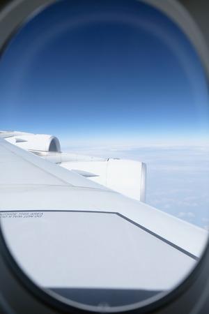 plane window: View through plane window Stock Photo