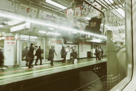 roughly: TOKYO, JAPAN -MARCH 29 2016 : rush hour. Most subway lines in Tokyo start at around 5 am and last trains depart at around midnight. In Tokyo the rush hour is roughly 7.30am-9.30am and 5.30pm-7.30pm.