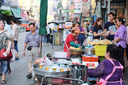 street market: CHINATOWN, BANGKOK,THAILAND-24 APRIL, 2016:street food at Yaowarat Road. Yaowarat road is various products such as street food, gold shop.Restaurant,etc., Famous and Popular destinations for tourists.