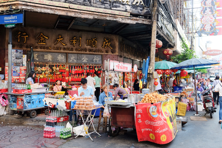 gold road: CHINATOWN, BANGKOK,THAILAND-24 APRIL, 2016:street food at Yaowarat Road. Yaowarat road is various products such as street food, gold shop.Restaurant,etc., Famous and Popular destinations for tourists.