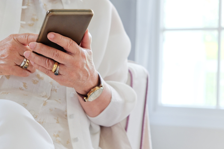 woman on phone: Senior woman using her mobile phone.